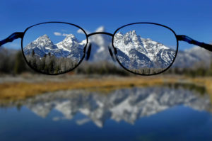 Glasses looking at mountains. How to create Vision for business, Executive networking